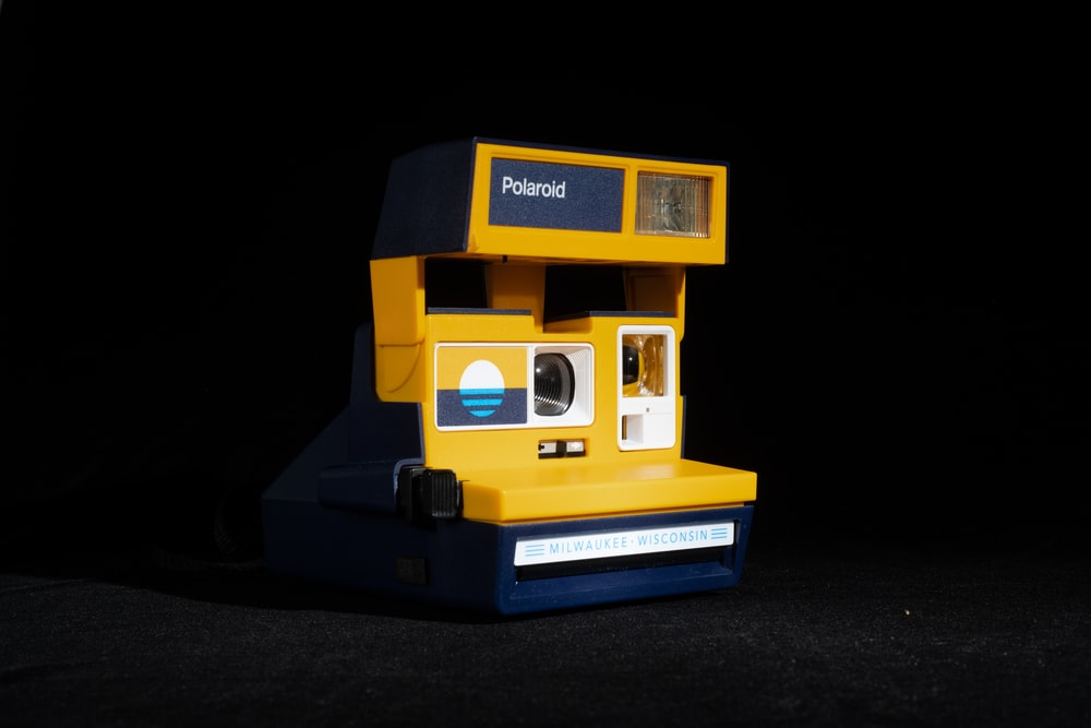 yellow and black polaroid camera
