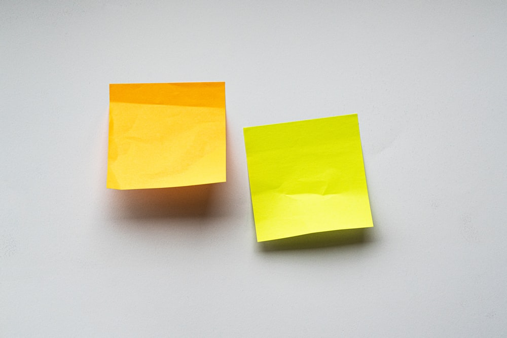 yellow sticky notes on white wall