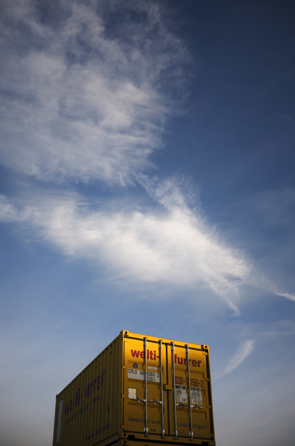 yellow and white building under blue sky