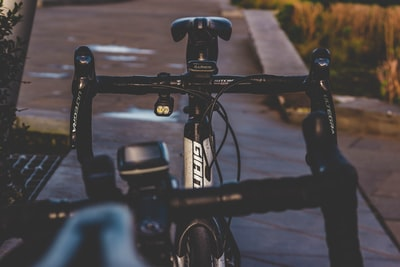 black city bike on road during daytime atmospheric zoom background