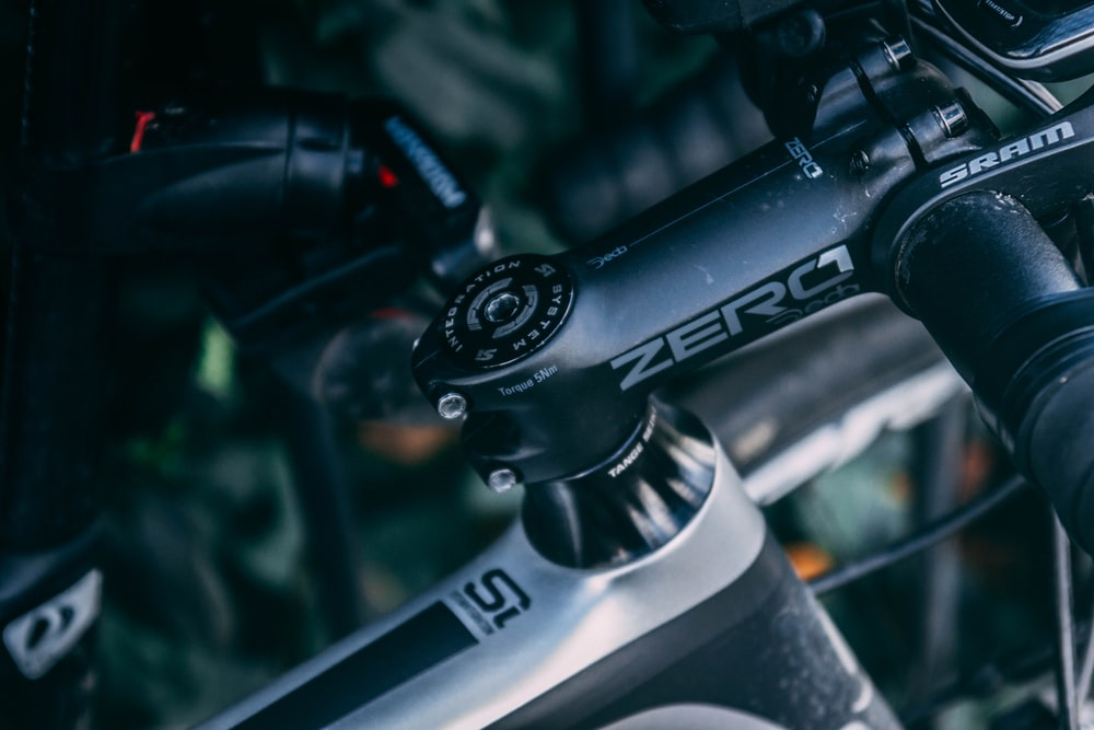 black and gray bicycle handle bar