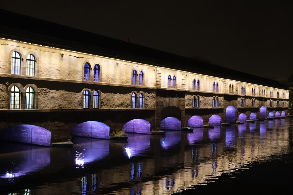 brown concrete bridge over river during night time