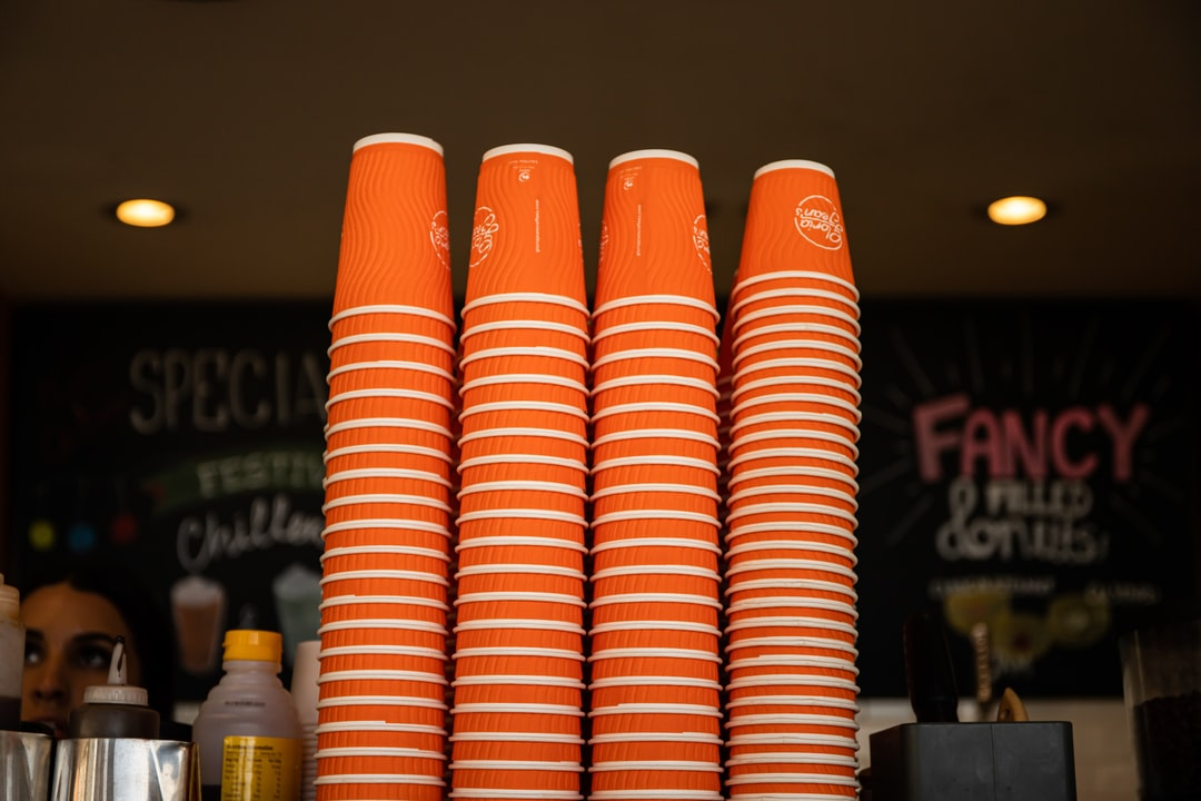Orange and White Plastic Cups - unsplash