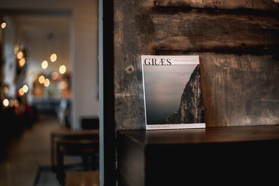 GRÆS Magazine, Issue One on a table in a cozy interior