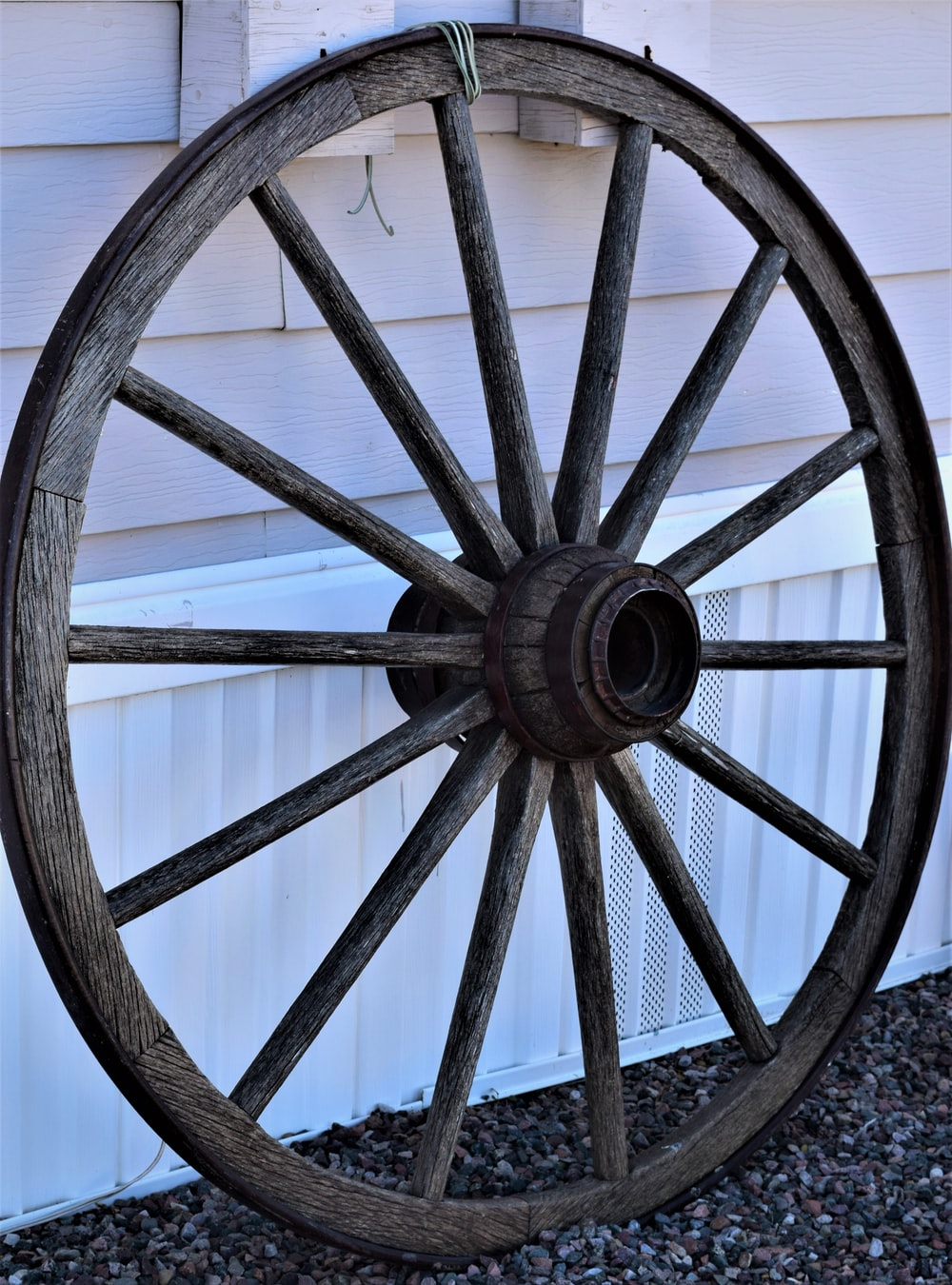brown wooden wheel on gray concrete floor