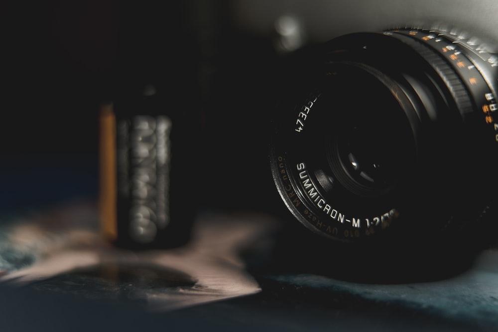 black camera lens on blue table