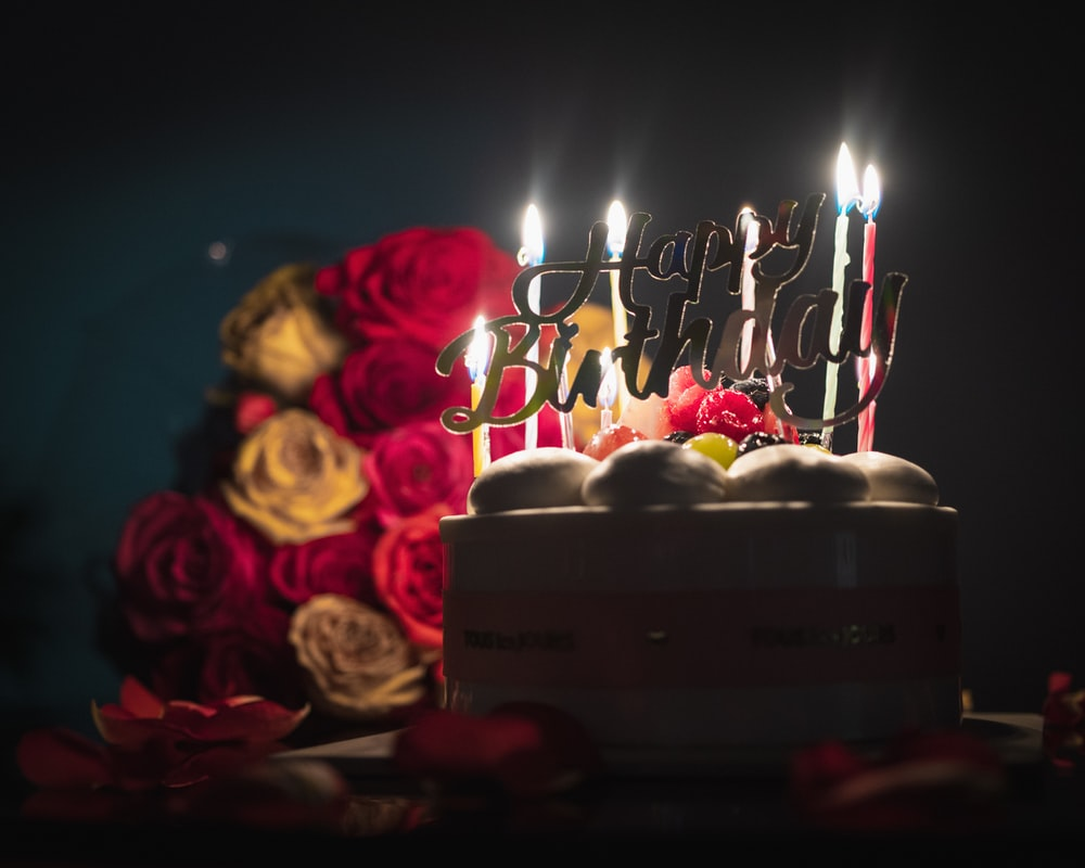 pink and white candles on cake