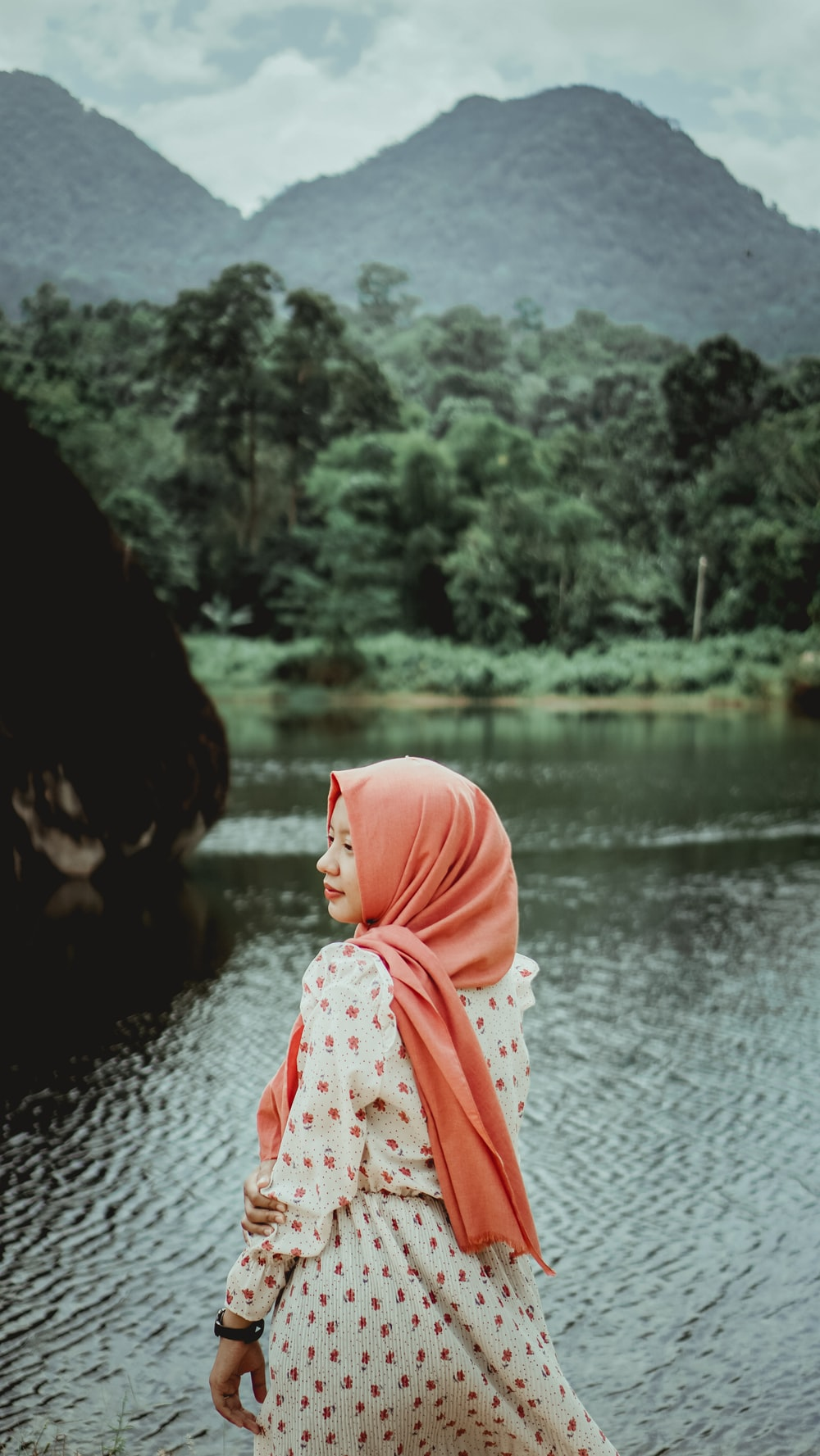woman in pink hijab near river during daytime
