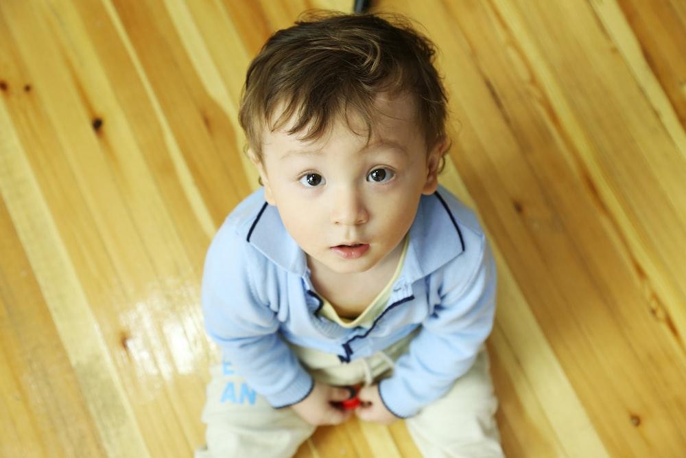 boy in blue dress shirt