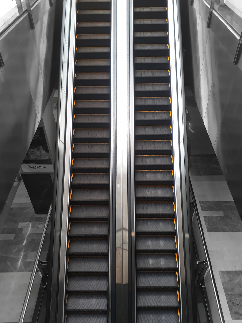 black and brown escalator in a room