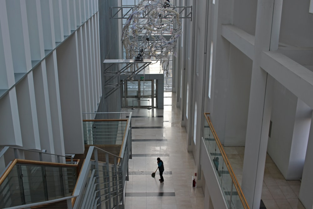 2 people walking on white staircase