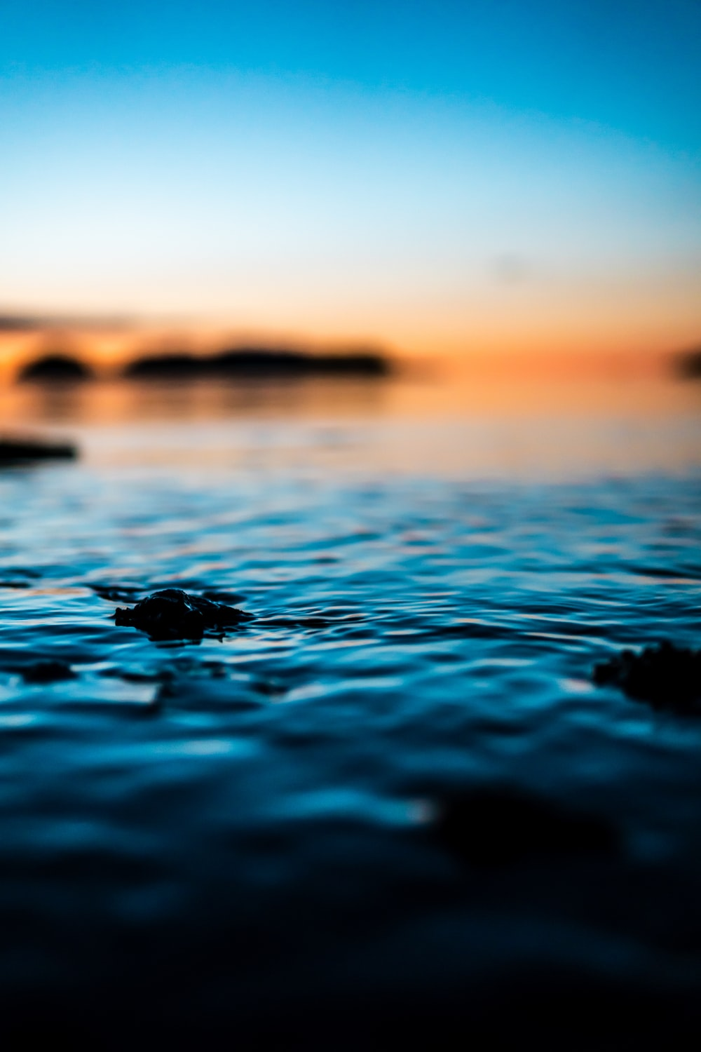 water on body of water during sunset