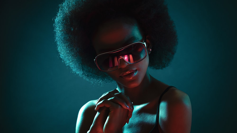 woman in brown framed sunglasses