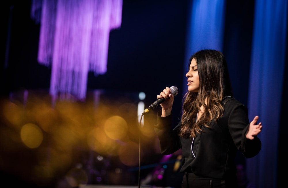 woman in black long sleeve shirt singing