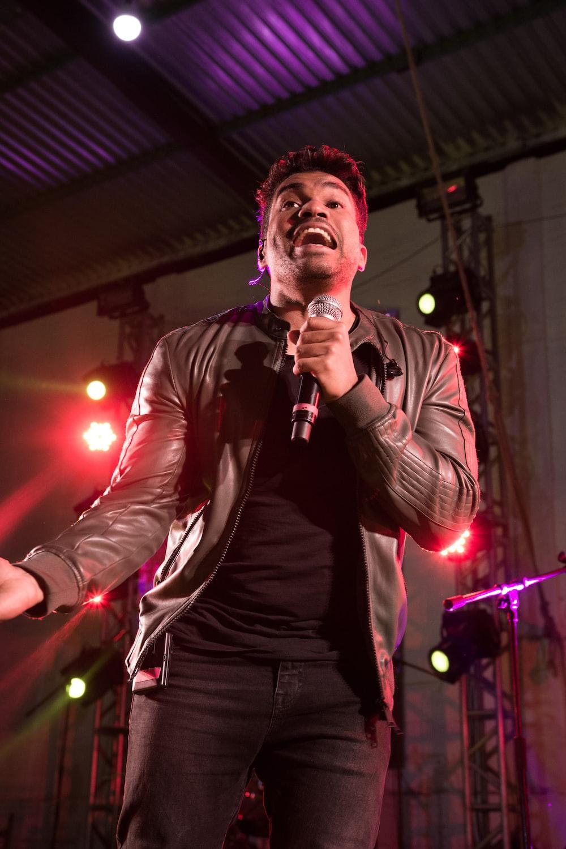 man in black leather jacket singing