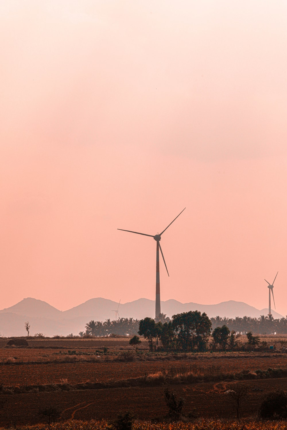 wind turbines on green grass field during daytime