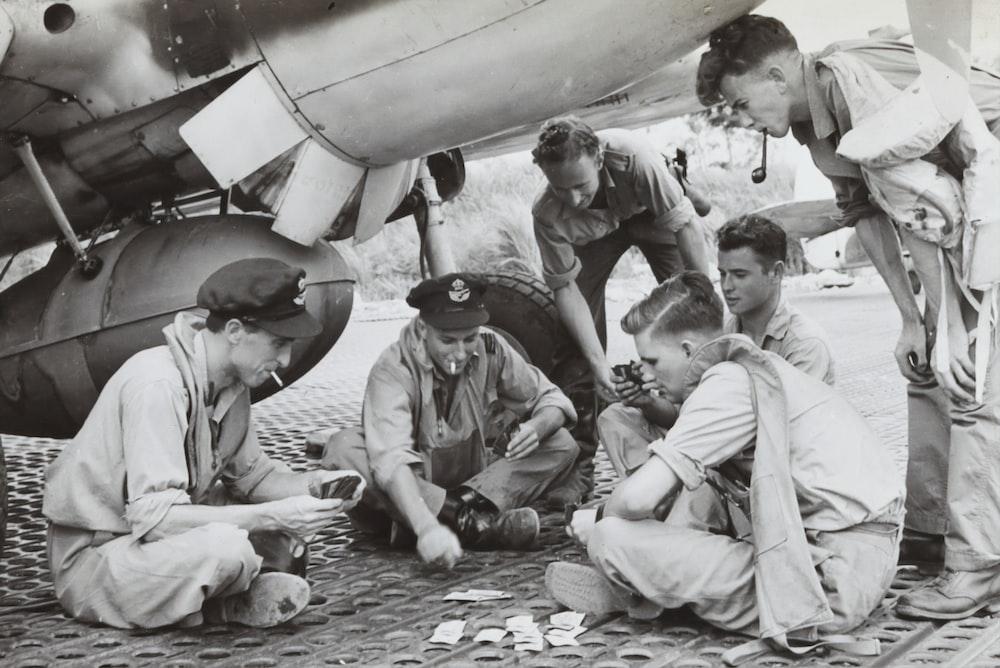 grayscale photo of children sitting on floor