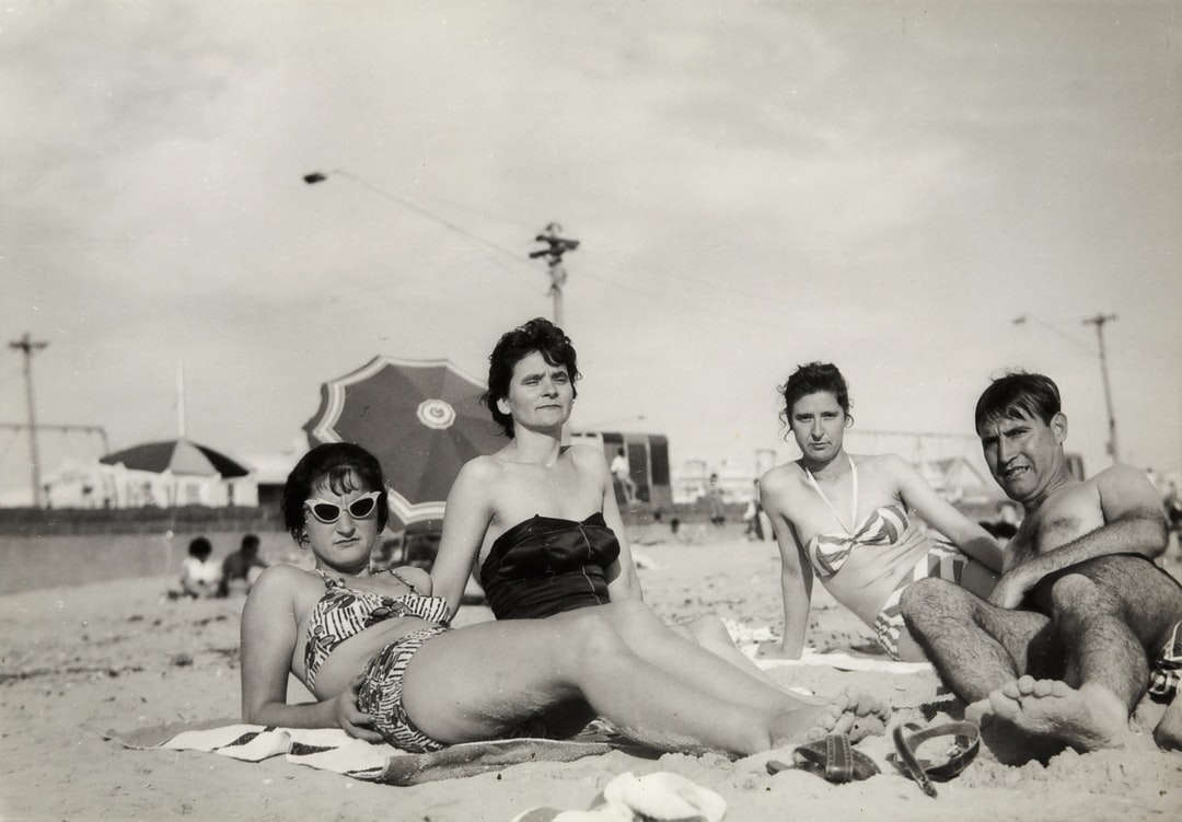 Three Women & Man Lying on Beach, Albert Park Beach, late 1950s