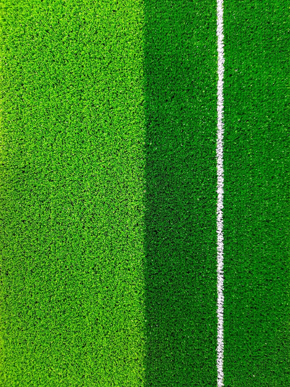 green and black stripe textile