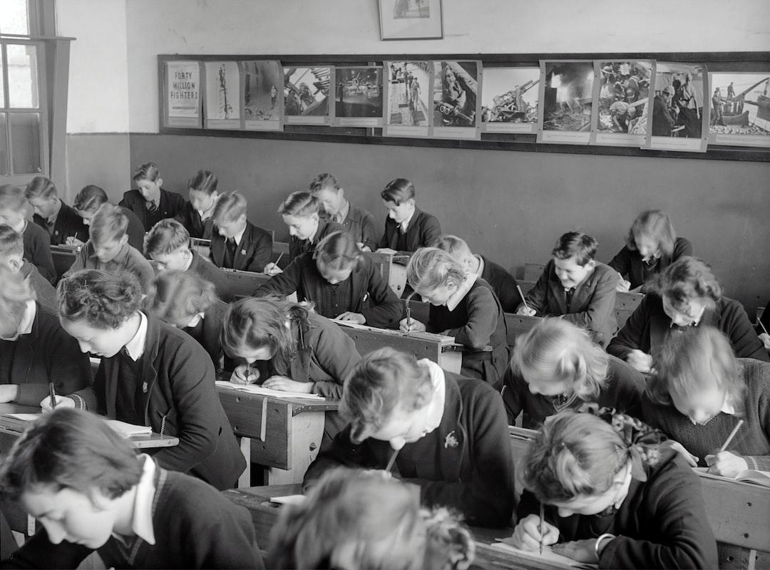 Interior of a classroom, students bent at study, Yallourn, 1947.