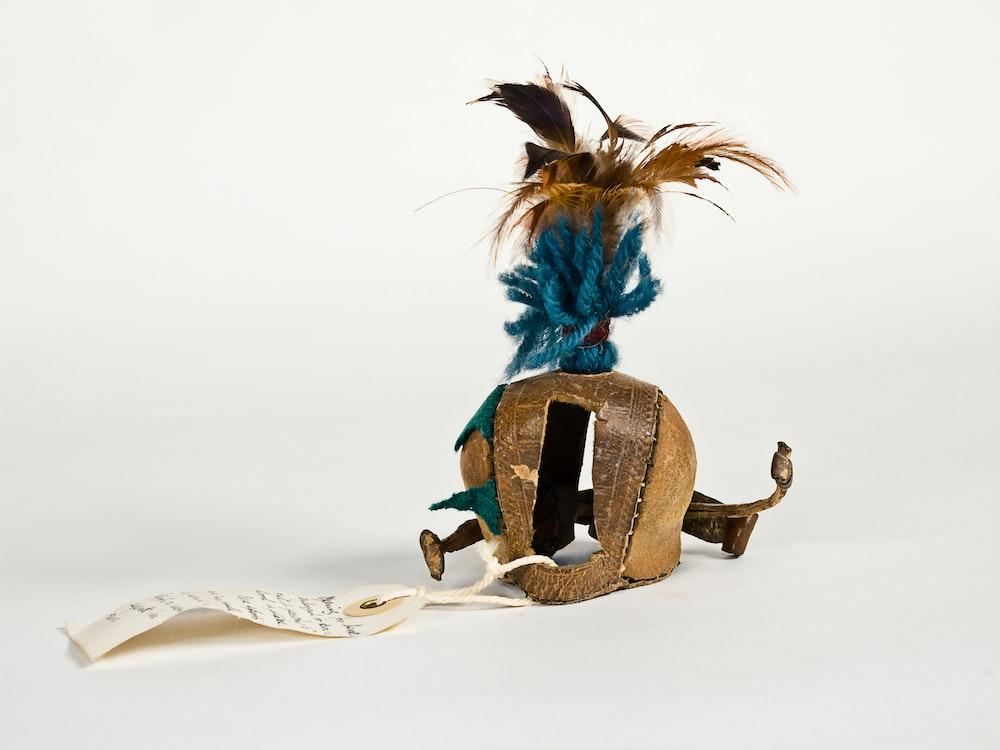 blue and brown bird figurine