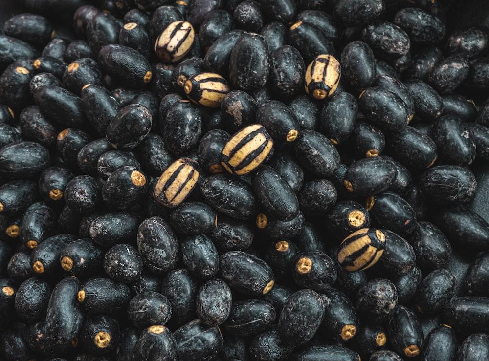 black and yellow round fruits