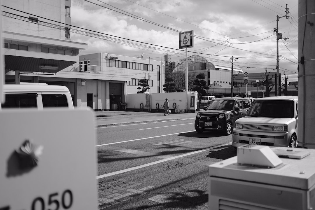 Grayscale Photo of Cars Parked In Front of Building - unsplash