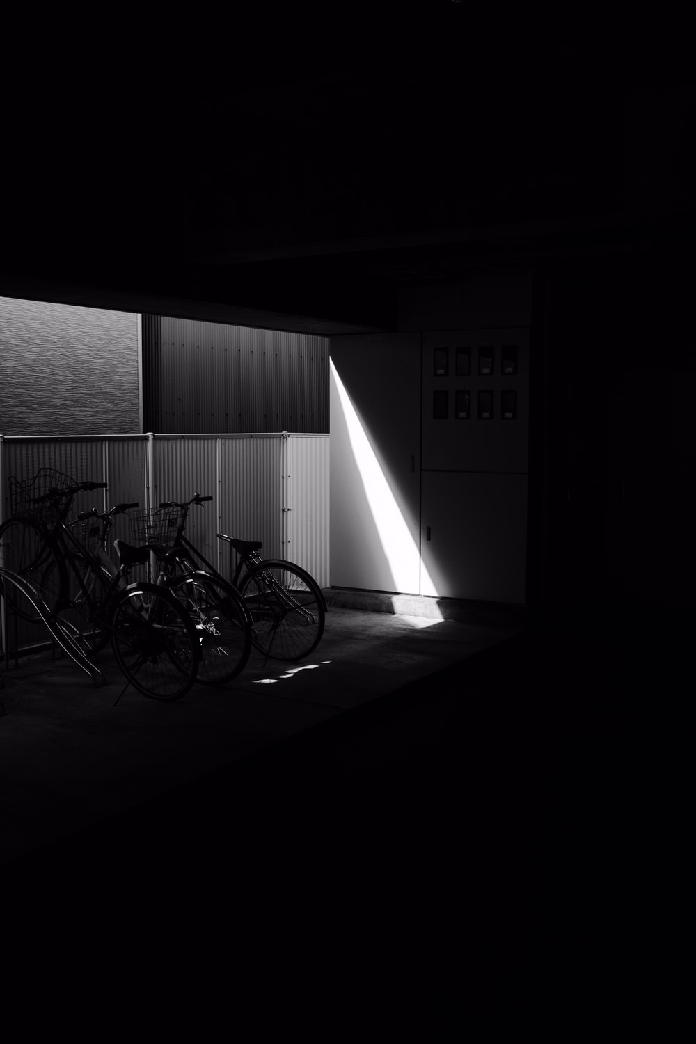 grayscale photo of bicycle in room