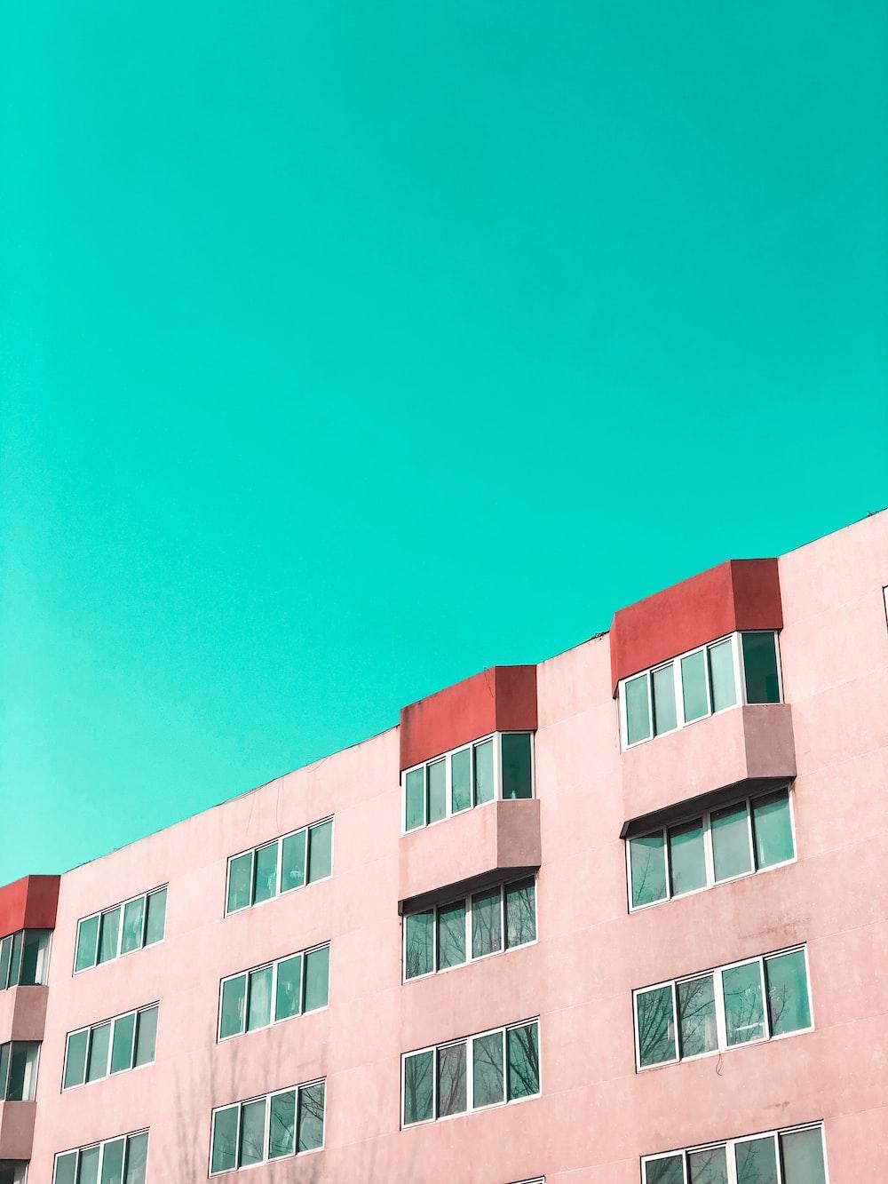 pink concrete building under blue sky during daytime