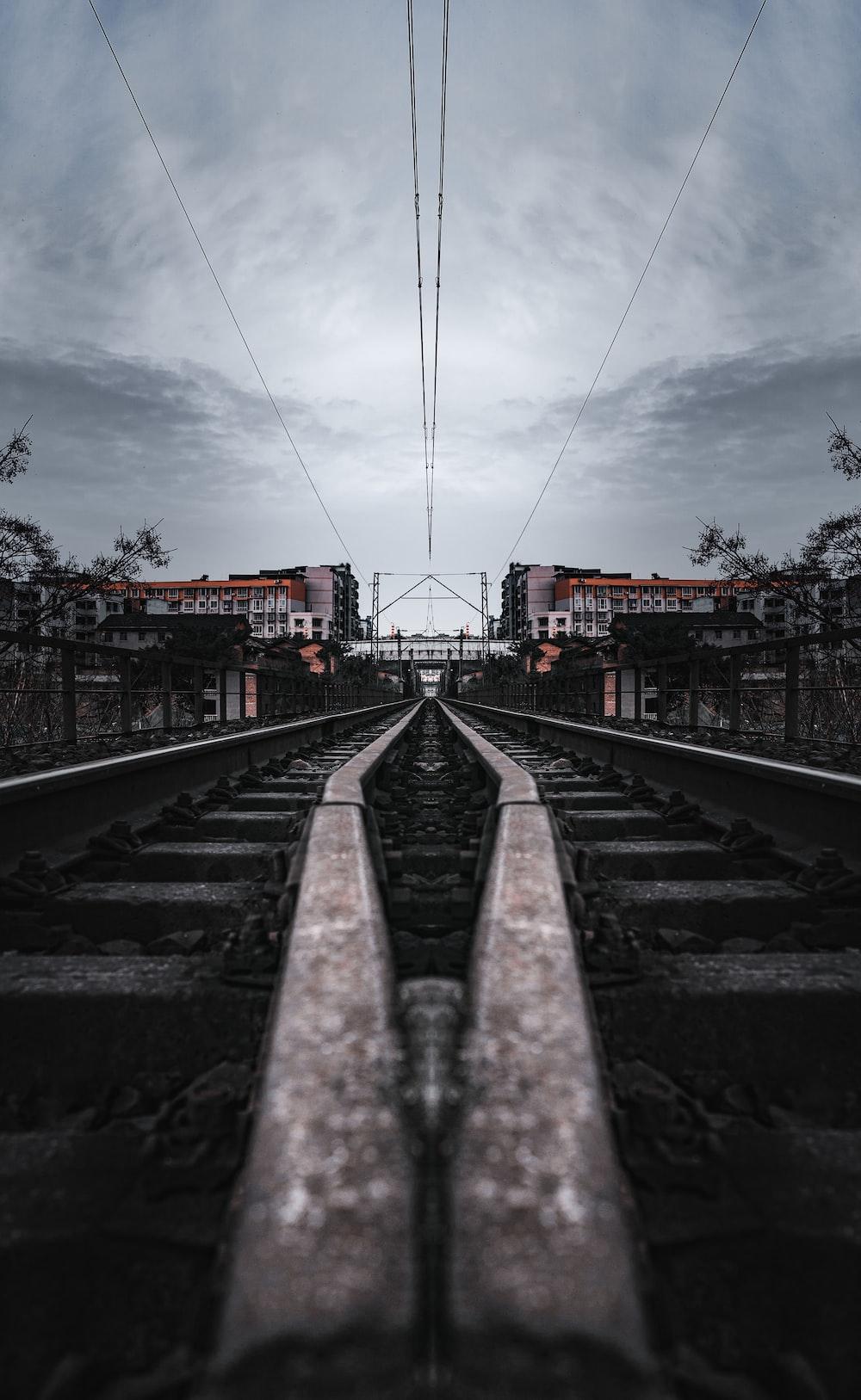 train rail under cloudy sky