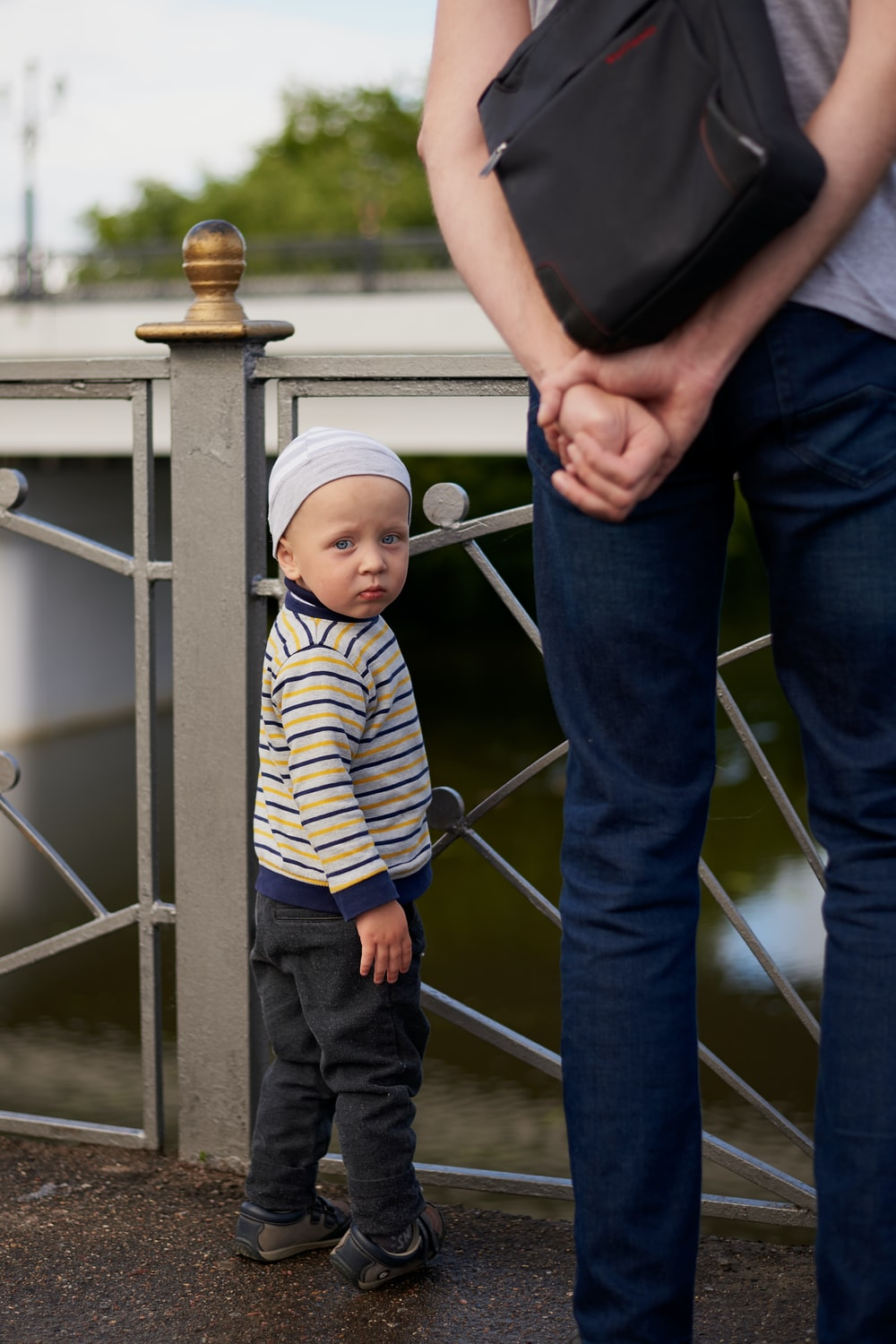 man in blue and white striped shirt carrying baby in blue and white stripe onesie