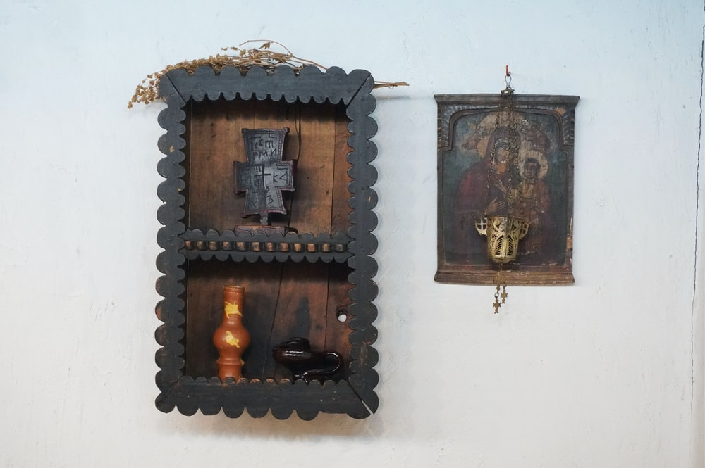 brown wooden wall mounted candle holder