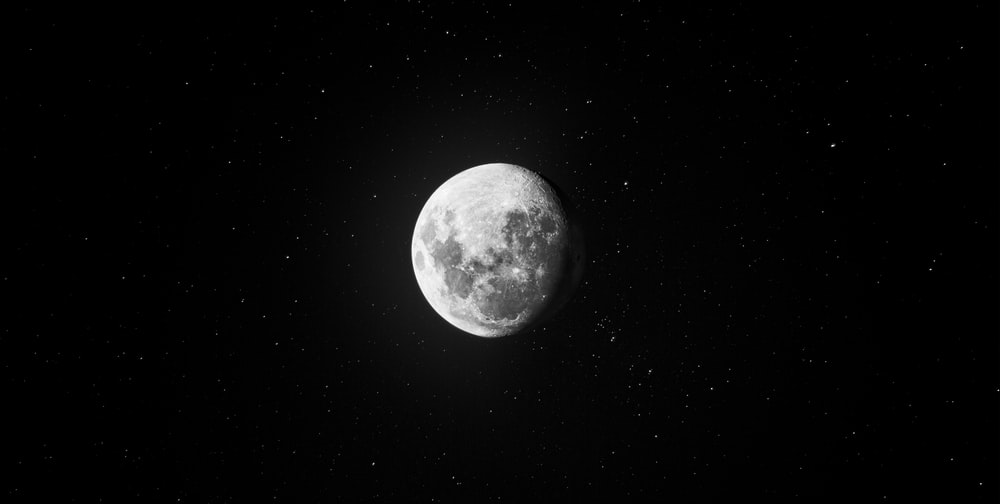 grayscale photo of full moon