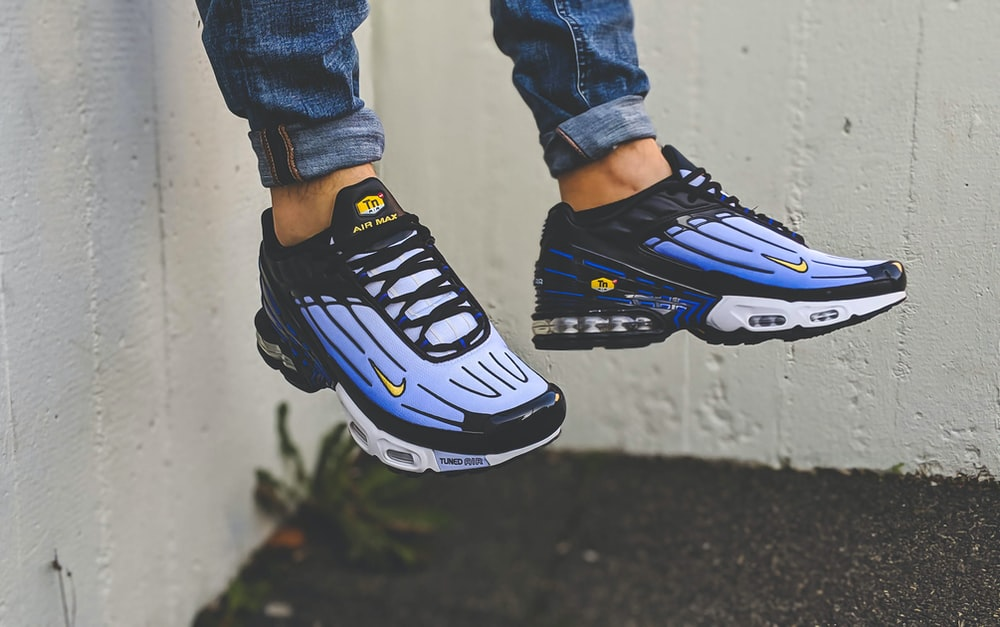 person wearing blue and white nike air max