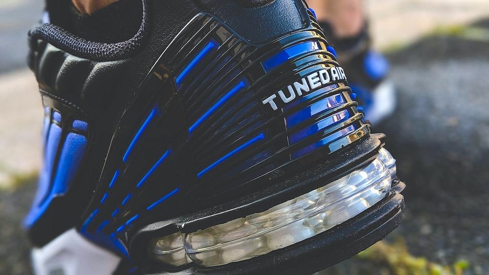 black and blue nike athletic shoe