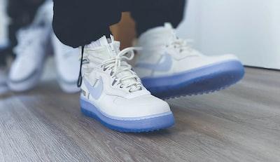 white and blue nike air jordan 1 shoes