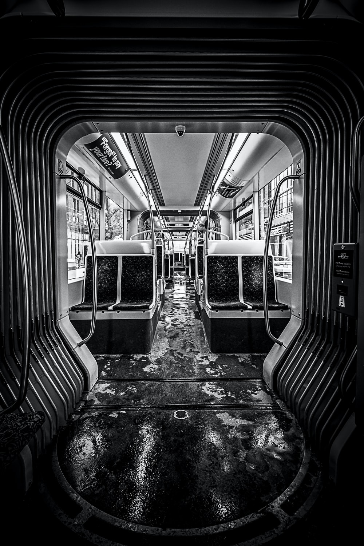 grayscale photo of train seats