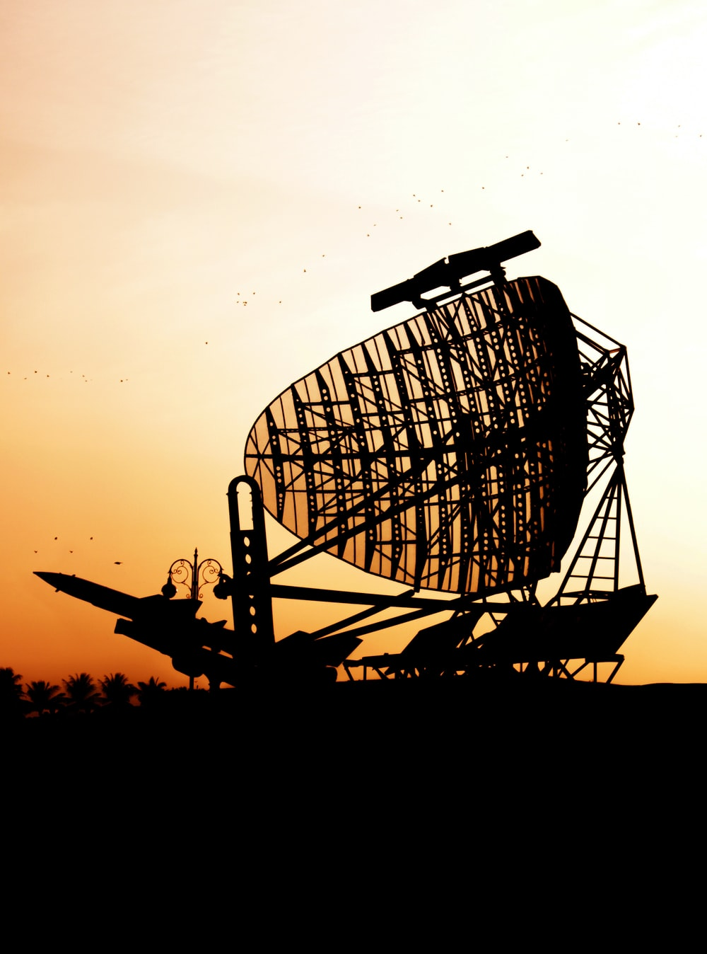 silhouette of airplane and satellite dish