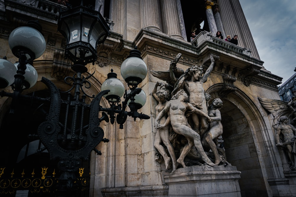 black metal cross with two men statue