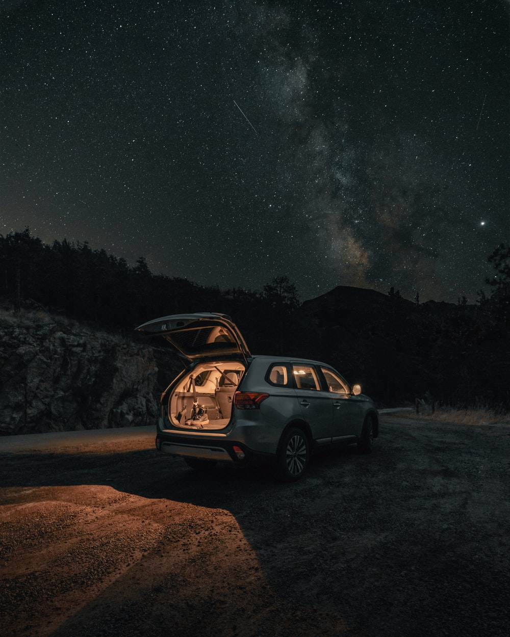 black suv on dirt road during night time