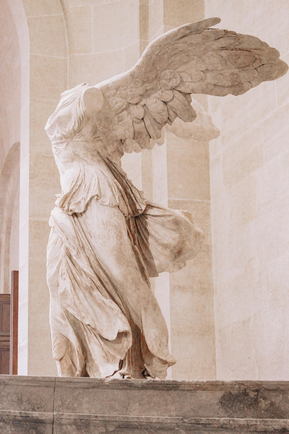 angel statue in white room