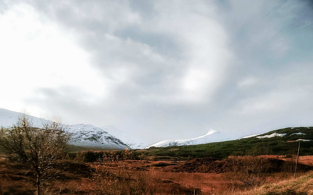 Snow blows off the top of a mountain in the Scottish Highlands.