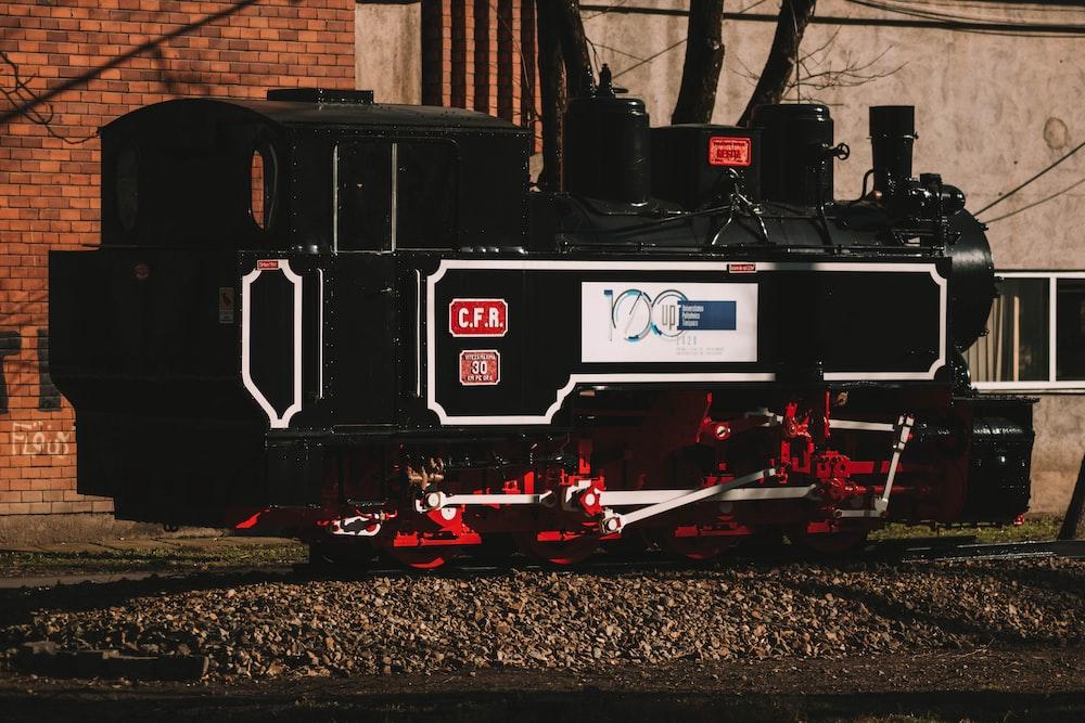 black and red train on rail tracks