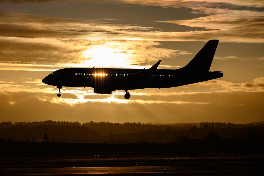 Airliner landing in Zurich with wonderfully golden sunset backlight.