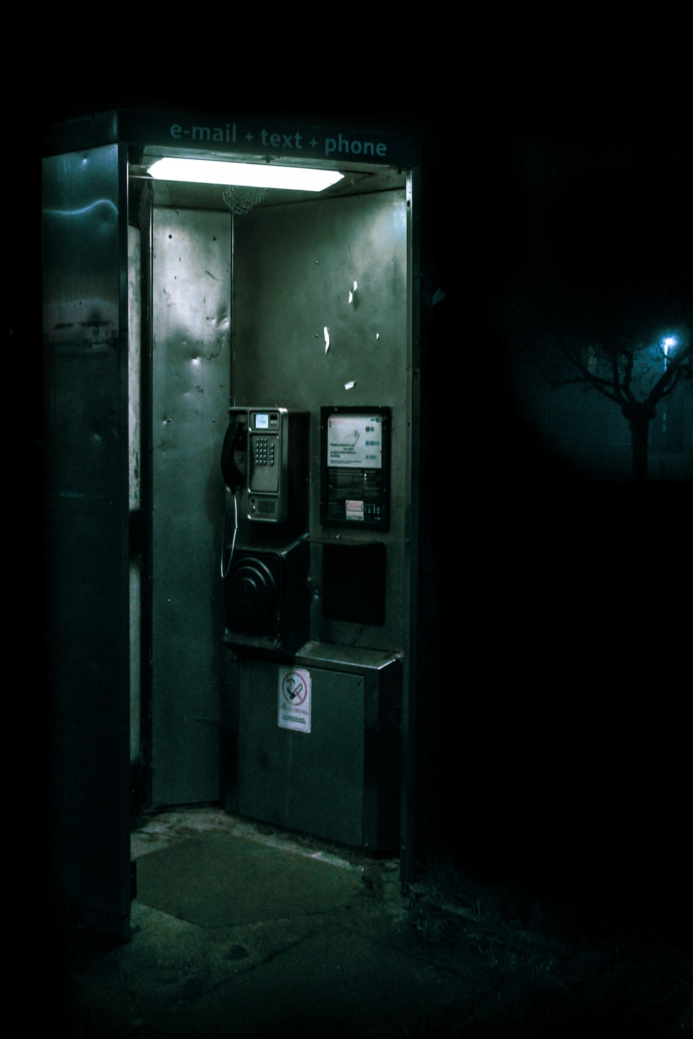 green and black telephone booth