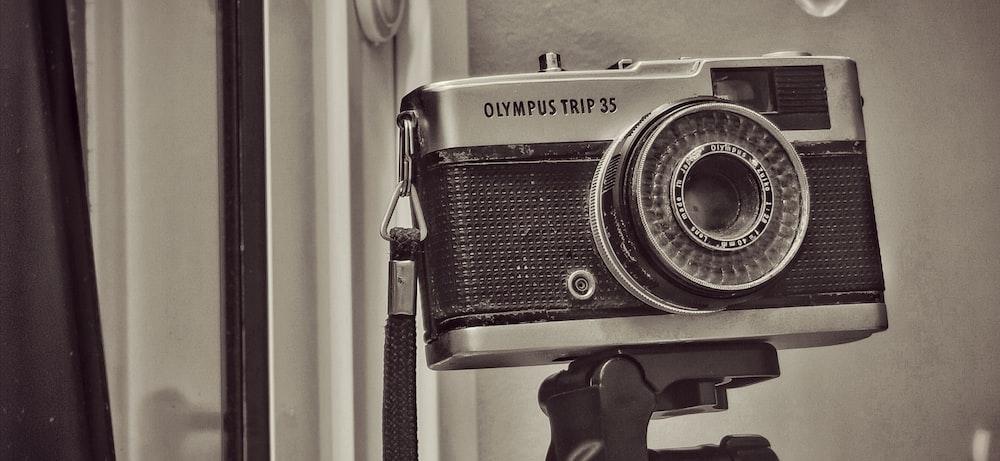 black and silver camera on black tripod