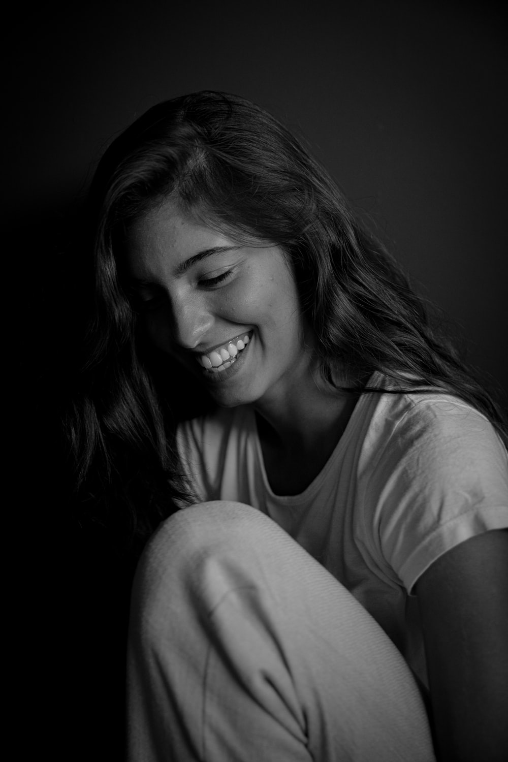 woman in white t-shirt smiling