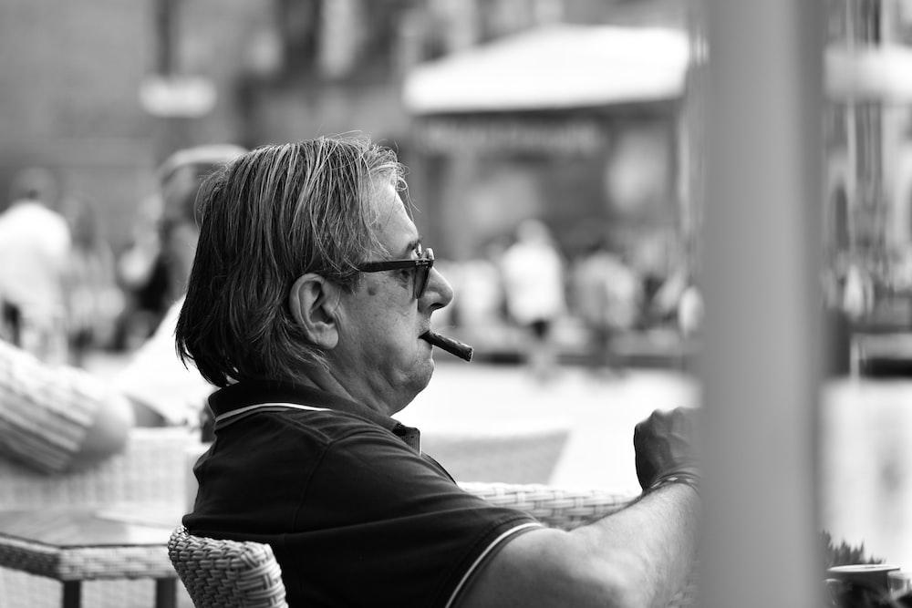 man in black shirt wearing black sunglasses