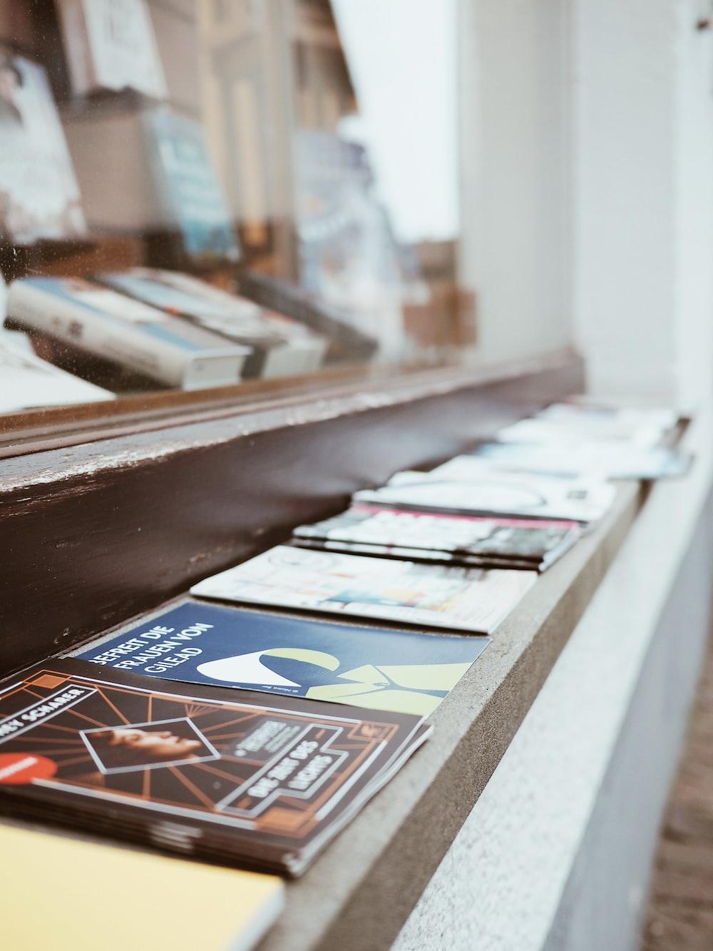 magazines on brown wooden shelf