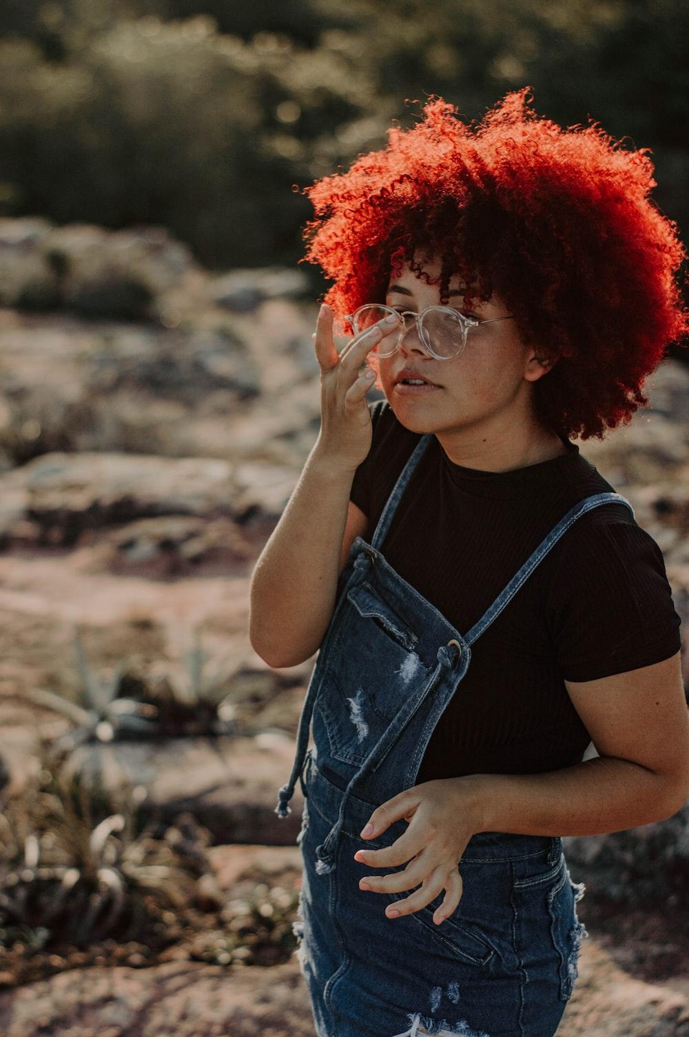 woman in black tank top wearing eyeglasses